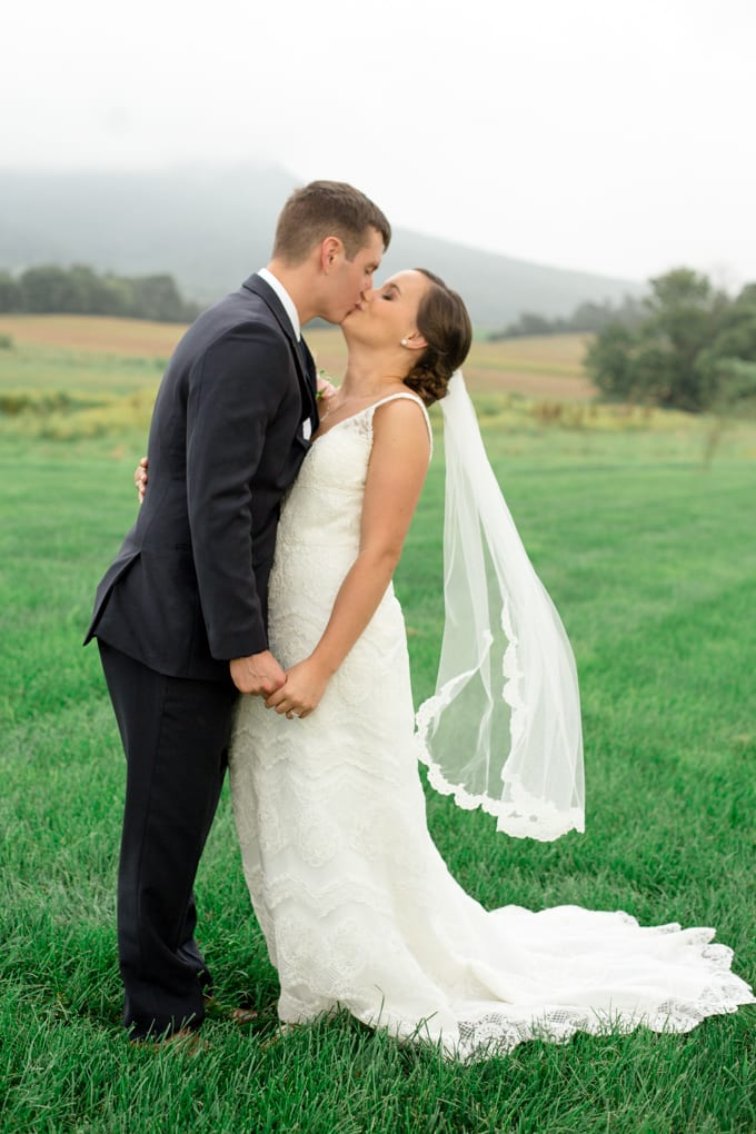 Bride and Groom Wedding Photograph with the Blue Ridge Mountains at Cross Keys Barn Wedding